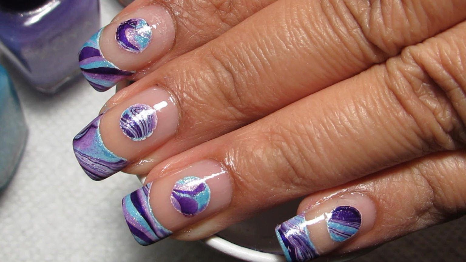 - Check Out This Unique Negative Space Water Marble Nail Design!