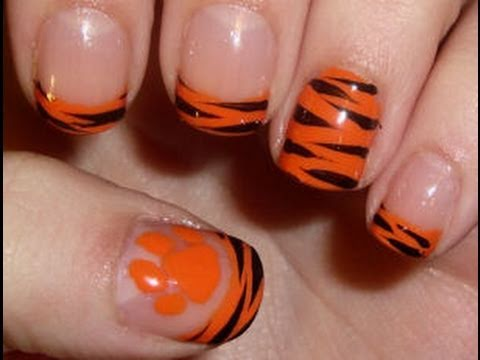 Check Out This Easy And Fierce Tiger Themed Nail Art Design