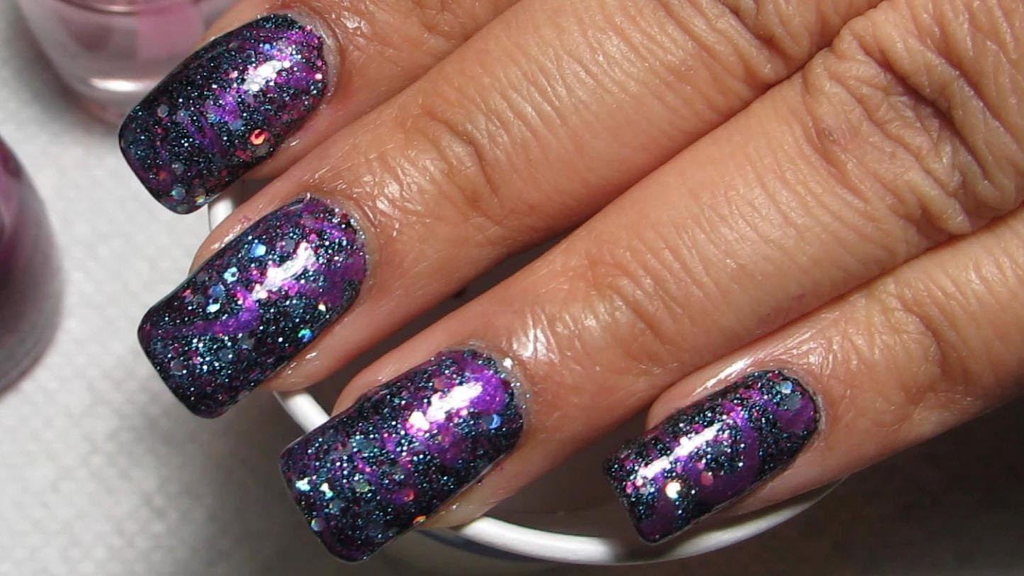 Try Out This Funky Glitter And Purple Water Marble Nail Art Design