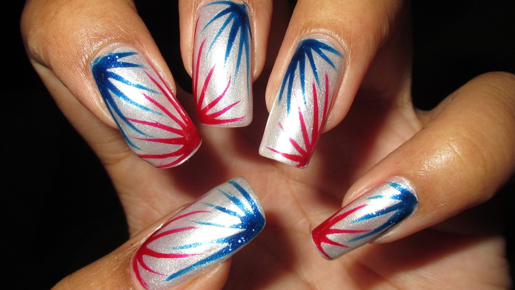 Get Festive With This Fun Fourth Of July Red White Blue Burst Nail Art